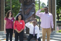 Teens pose outside The Castle Group during a job shadow day