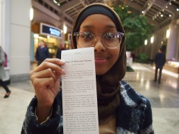 Yasmin shows off her story, printed receipt-sized from the story dispenser in Prudential center, Boston