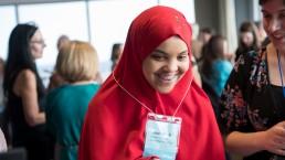 Student smiling and celebrating at WriteBoston's Pros&Conversation fundraiser