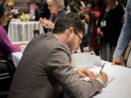 Joshua Foer signing books