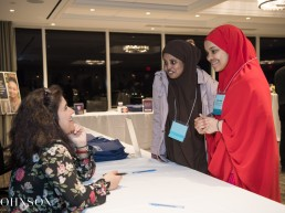 Two high school students talking to Marjan Kamali