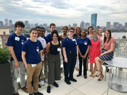 students at sanofi genzyme with boston skyline