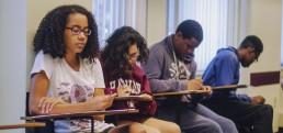 Malia, a student at SJI writing an article