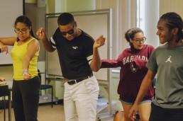 teens in print students dancing in class