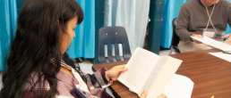 Writing Center Student reading a book