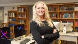 Chelsea teacher Roxy standing in library